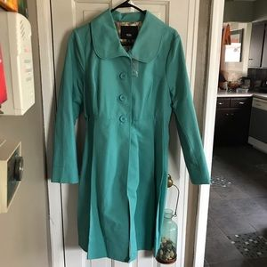 Turquoise color spring coat.